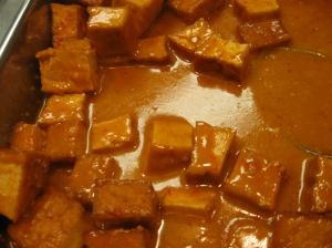 Tofu - too much soy isn't so good, but the protein would be helpful today.